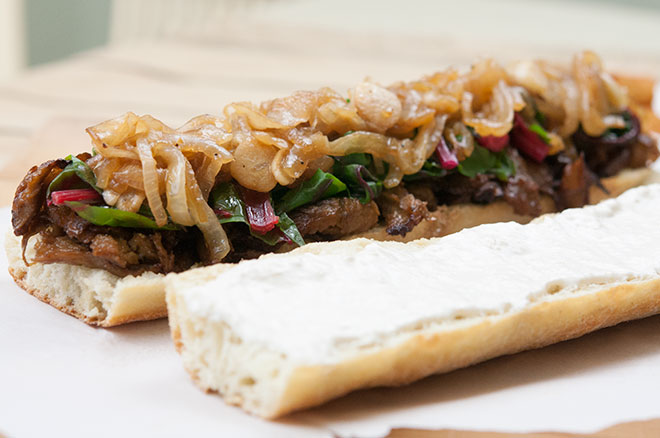 Vegan Maple Glazed Seitan Sanwich, w/ Beer Braised Onions & Garlic, Swiss Chard, & Horseradish Cream